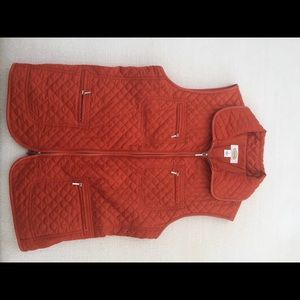 Quilted vest in burnt orange color.